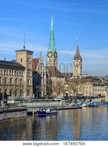Zurich, Switzerland - 29 January, 2017: well-known buildings of the city of Zurich: the City Hall, the Fraumunster Cathedral, clock tower of the St. Peter Church. Zurich is the largest city in Switzerland.
