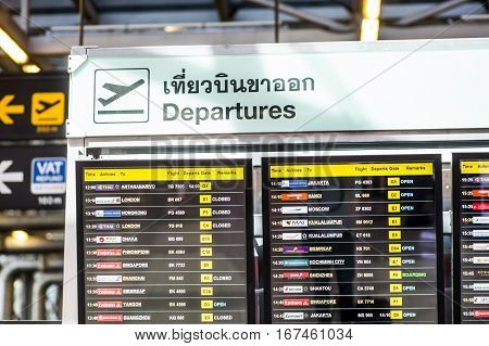 Bangkok Thailand - 29 November 2015: Departure board displaying flight numbers gates and times at Bangkok's main international airport