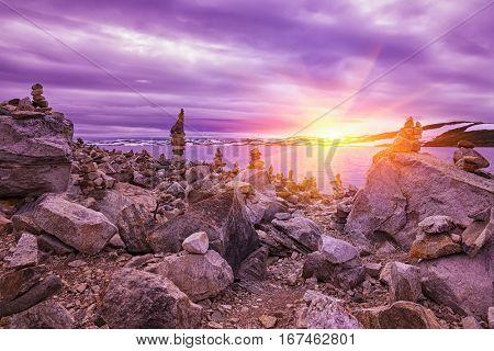 Beautiful sunrise over Rocks in a lake, Winter Landscape, Norway