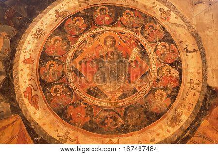 MTSKHETA, GEORGIA - OCT 13, 2016: Symbolic portraite of Jesus Christ and zodiac signs on ancient wall fresco of Svetitskhoveli Cathedral built in 4th century on October 13, 2016. UNESCO Heritage Site
