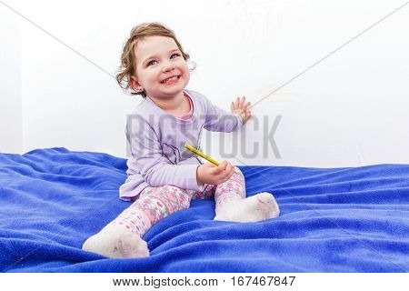 Photo of adorable child smiling to the camera