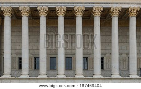 Neoclassical style row of columns on a building. The colonnade is kept in corinthian style, resembling a Greek or Roman temple.