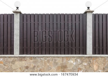 New wooden fence with concrete pillars equipped with street lights on a stone foundation isolated on white background clipping path included