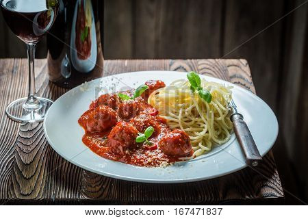 Delicious Spaghetti Bolognese With Meatballs And Parmesan