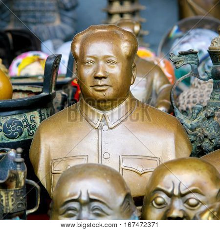 BEIJING CHINA - SEPTEMBER 17 2007: Bust of Chairman Mao and other memorabilia on an antique market in Beijing China