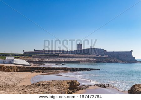 Stone fort in the beach as the entrance of a prison in a small island in the middle of the ocean.