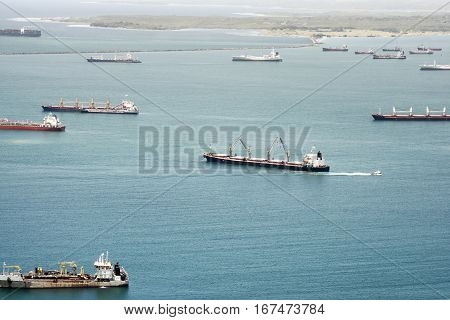 Aerial view of large cargo ships waiting at Gatun Lake to pass through Panama Canal