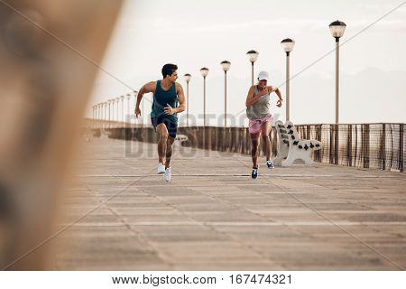 Fitness Couple Sprinting On The Promenade
