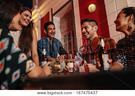 Young People On Rooftop With Drinks