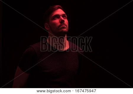 One Man Looking Above Up, Red Color Light
