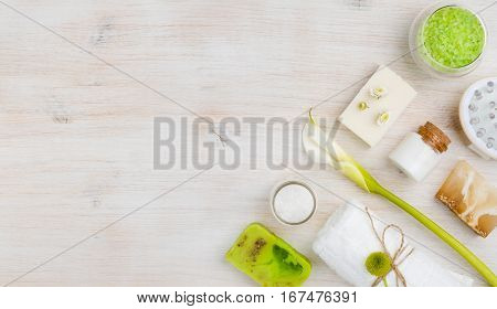 Different spa products on wood with copy space at left