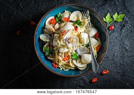 Tasty Spaghetti Vongole With Clams, Parsley And Peppers