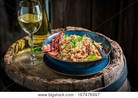 Fresh Spaghetti Carborana With White Wine On Old Barrel