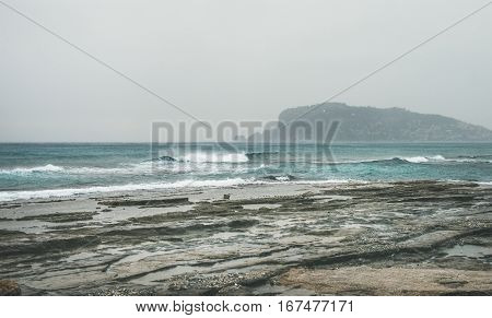 Stormy winter day with waves at Mediterranean sea coast in Alanya, Mediterranean region, Turkey