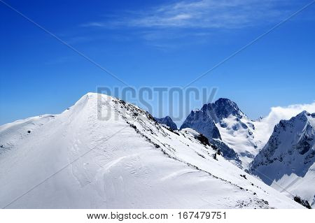 Slope for freeriding in sun winter day. Caucasus region Dombay top of mount Musa Achitara.