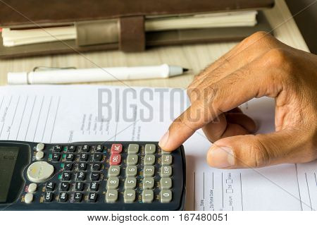 a man is calculate his business by calculator