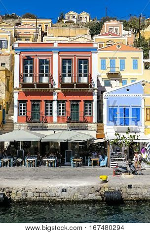 Picturesque harbor with colorful houses of Symi town, Dodecanese, Greek island