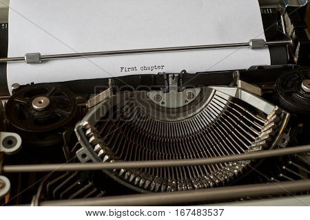 First chapter typed words on a Vintage Typewriter