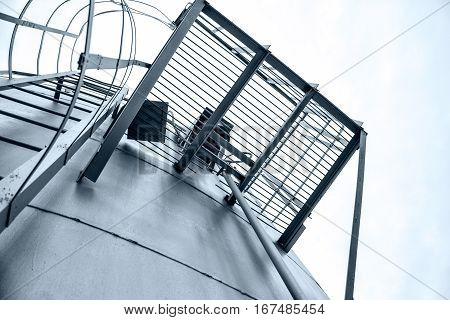 vertical metal ladder on the tank roof and playground