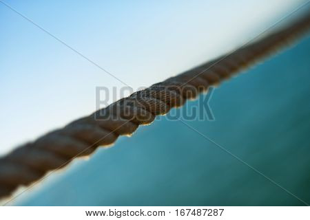 wire rope bisect sky and water diagonal