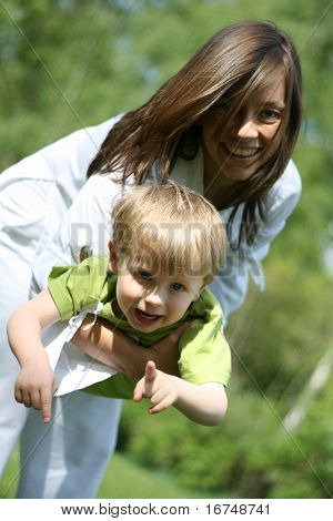 mother and three years old boy having fun - leisure activity