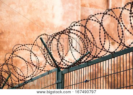 barbed wire fence used for protection purposes of a pproperty