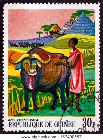 GUINEA - CIRCA 1967: a stamp printed in Guinea shows Lan the Child Buffalo African Legends circa 1967
