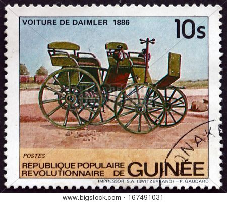 GUINEA - CIRCA 1984: a stamp printed in Guinea shows Daimler Automobile 1886 circa 1984