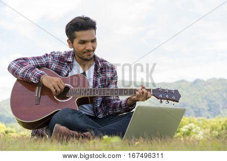 Handsome Man Smiling, Playing Guitar