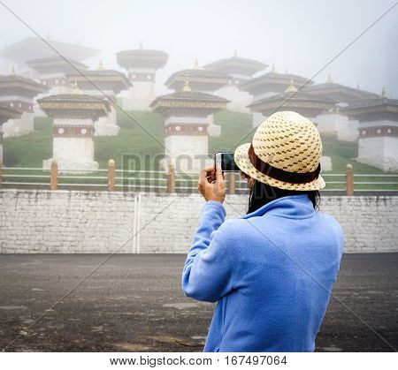 Tourist Taking Images At Tibetan Temples