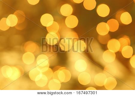 Golden Christmas lights blurred in the background