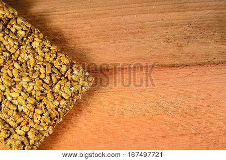 Brittles with sunflower seeds on a wooden table. Top view