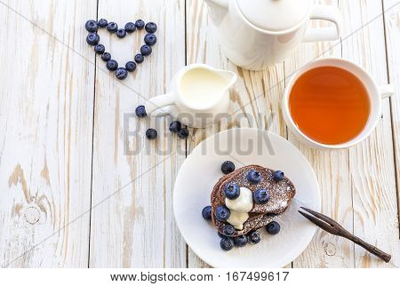 Hot Tea And Buckwheat Chocolate Pancakes With Blueberries