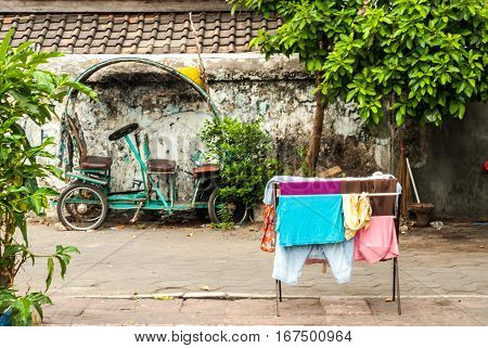 Scene behind the city walls with laundry and vehicle in Yogyakarta, Indonesia