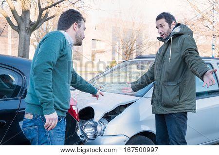 Two Men Arguing After A Car Crash Accident
