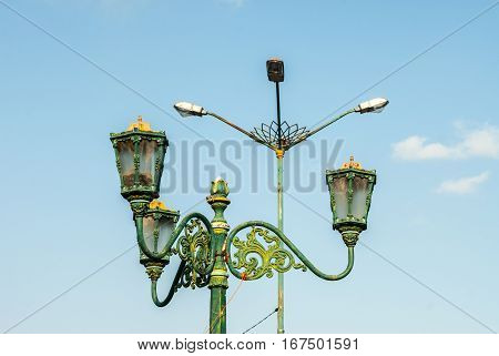 Juxtaposition of Streetlamps old and new on Kraton square in Yogyakarta