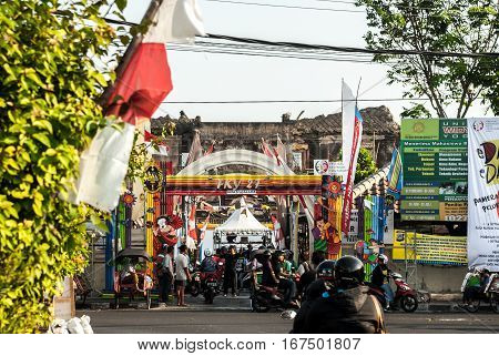 Yogyakarta, Indonesia - September 2, 2015: Busy street scene in front of entrance to Taman Sari area where festivities are going on