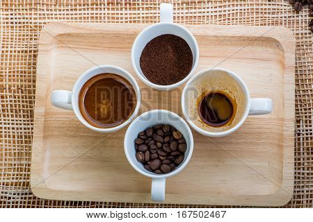 Cup Of Coffee On Coffee Beans Background On A Wooden Table