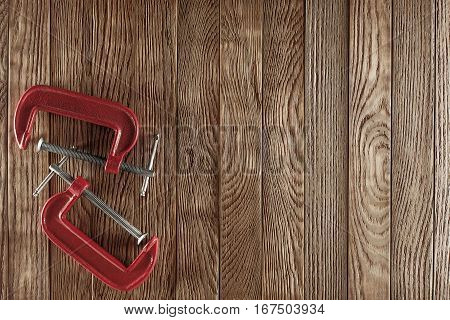 red clamp on the old wooden background