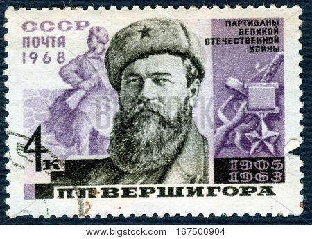 USSR - CIRCA 1968: Postage stamp  printed in USSR shows portrait of P. P. Vershigora (1905-1963), Hero of the Soviet Union, from the series