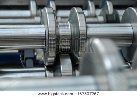Roll forming machine component used for shaping the sheet metal roofing