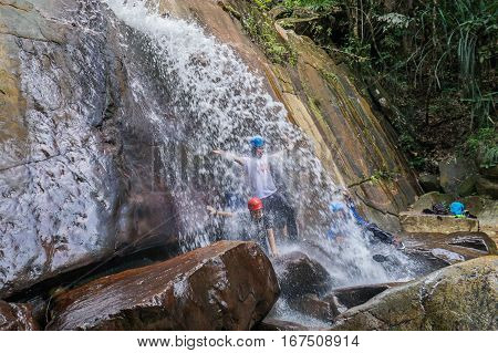 Beaufort,Sabah,Malaysia-Jan 28,2017:A group of adventurer enjoying and having fun in waterfall Beaufort,Sabah,Borneo.Rivers and waterfalls add attractive dimension to the Beaufort,Sabah,Borneo.