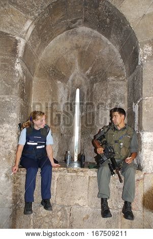 JERUSALEM, ISRAEL - JULY 24, 2007: Israeli soldiers guards have coffee break at the Jewish Quarter in Old Town of Jerusalem, Israel.
