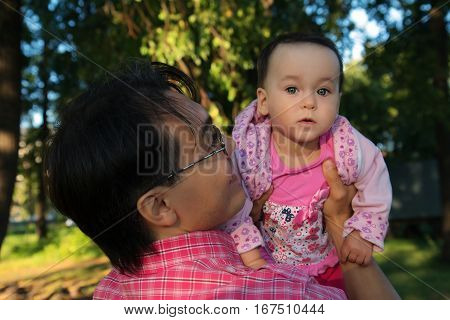 Close up portrait of Father and baby daughter in the Park