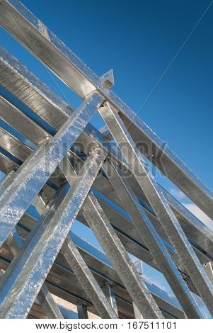 Galvanized steel roof construction elements with sky background