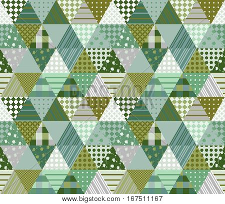 Seamless patchwork pattern from triangle patches. Vector illustration. Quilt in summer green tones.