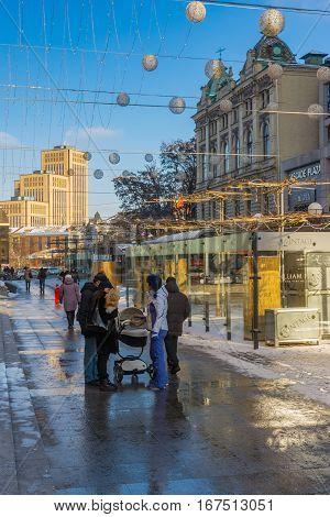 DNEPR UKRAINE - DECEMBER 16, 2016:Winter landscape on European square at weekday afternoon in Dnepr, Ukraine, at December 16,2016