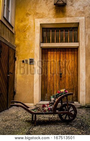 Wooden cart with flowers in a courtyard