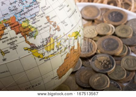 Turkish Lira Coins By The Side Of A Model Globe