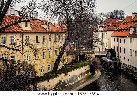 Water mill and buildings on the Vltava River in Prague Czech Republic